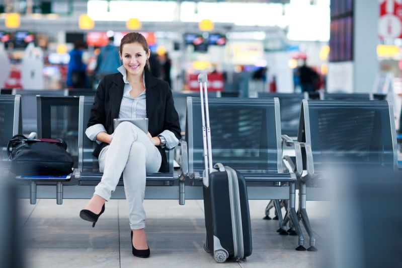 Woman at the airport with luggage
